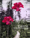 Cairns cover with pink flowers and trees